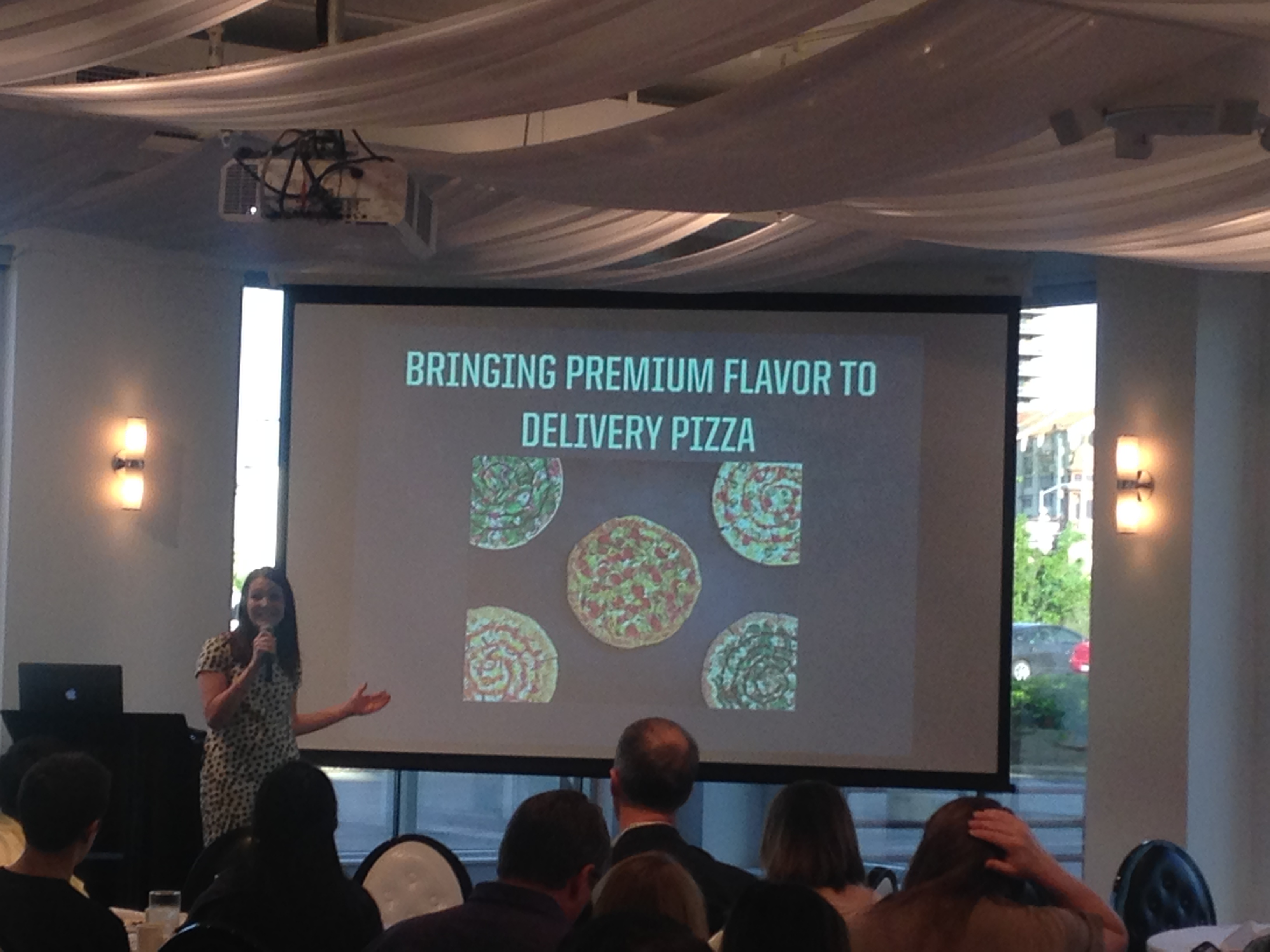 Pizza Hut employee presenting at social media club