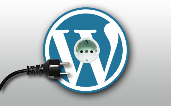 wall electrical socket with WordPress logo