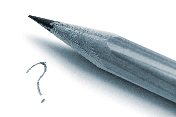 Photo close-up of pencil with a question mark written on paper under pencil.