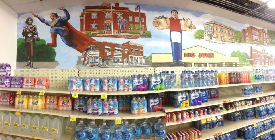 Photo example of wall mural in Big John grocery store with Superman because store is in town named Metropolis.