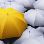 yellow umbrella among gray